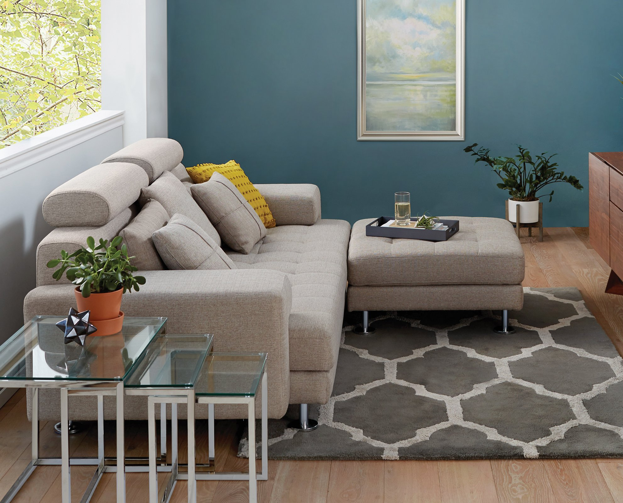 The cepella sofa offers all around comfort with a low profile and wide track arms chrome legs and detailed tufting create an overall modern look