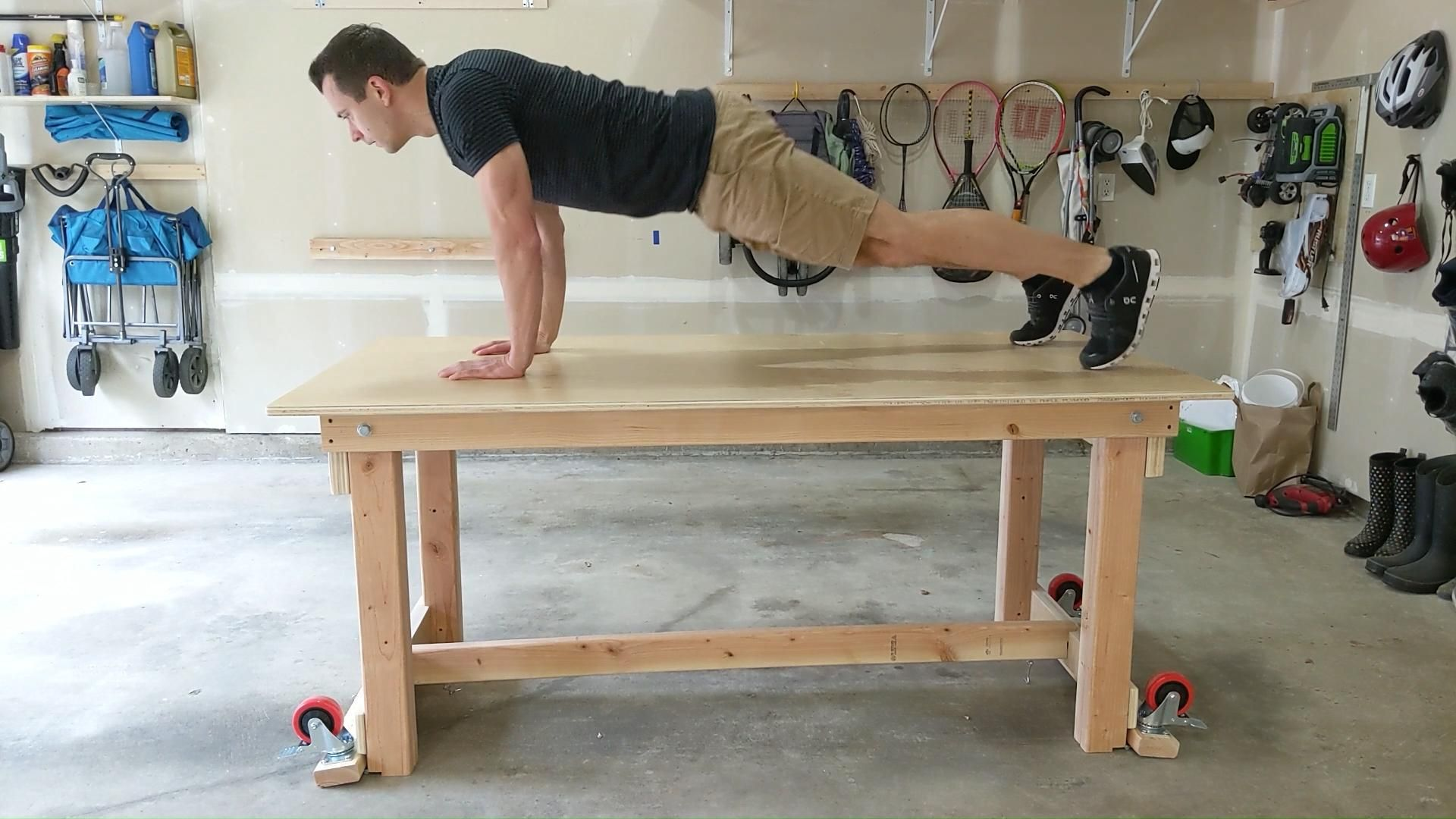 My DIY foldable wall mounted workshop table - Wheels fold / unfold and stability demonstration
