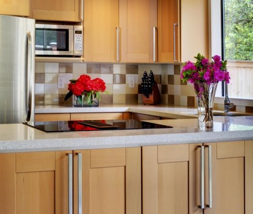 Maple Kitchen Countertops: White Countertops, Light Cabinets, Weird Tile Backsplash