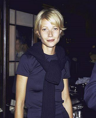 Posh 90's fashion. That sweater looks too heavy for her. She looks ...