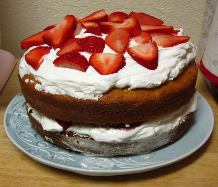 Simple white cake with whip cream and fresh strawberries - Just made, looks lovely! Very easy and pleasing for summer.