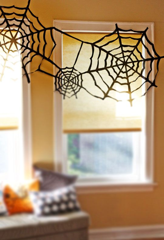 A spider web made from a trash bag\u2014 seriously! You can make some - cool halloween decorations you can make
