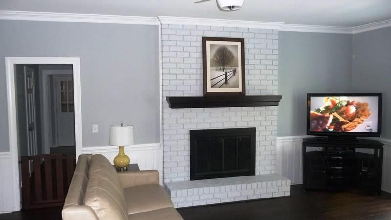 Amazing White Brick Fireplace With Black Mantle All In One Fireplaces