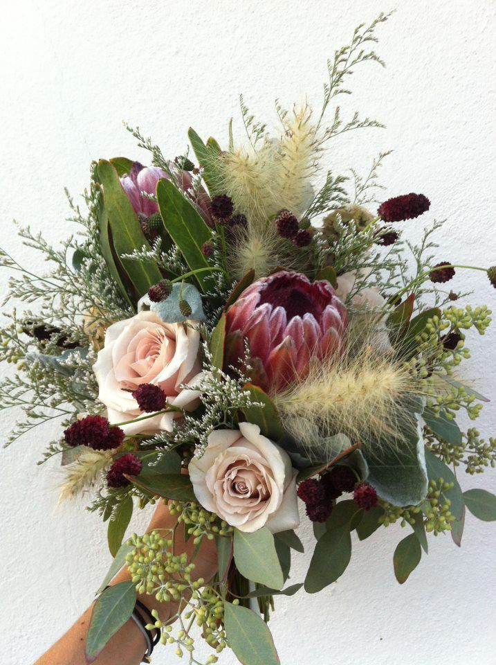 Pink Ice Protea And Roses Love The Grasses And Foliage Wedding Flowers Bridal Bouquets Wedding Bridal Bouquets Flower Arrangements