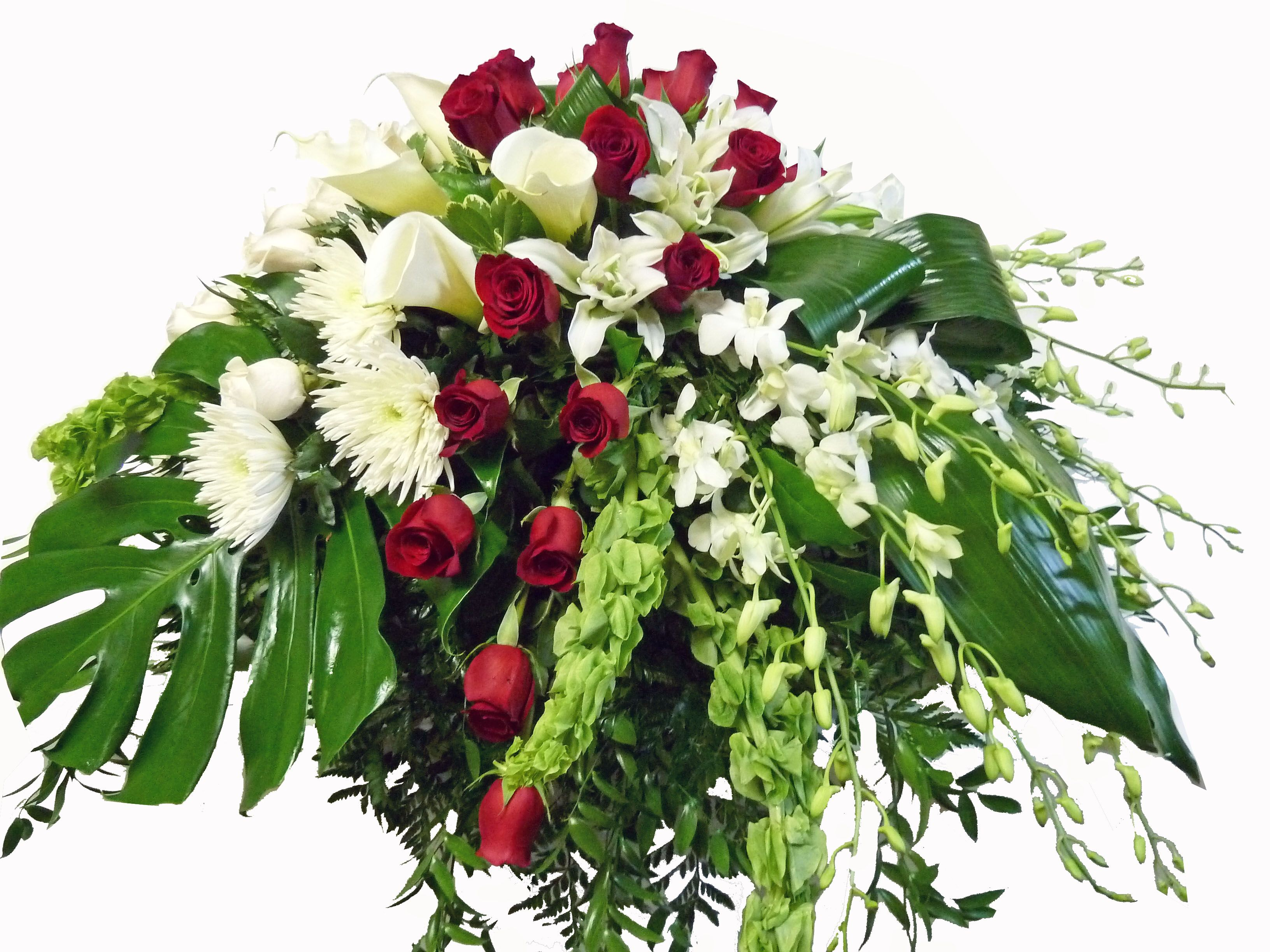 Modern styled casket spray for a funeral. The red and