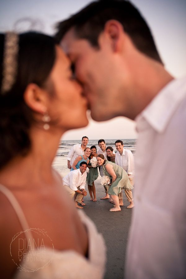 After sunset on the beach- bridal party peaks through...Photo by Diana Deaver Weddings