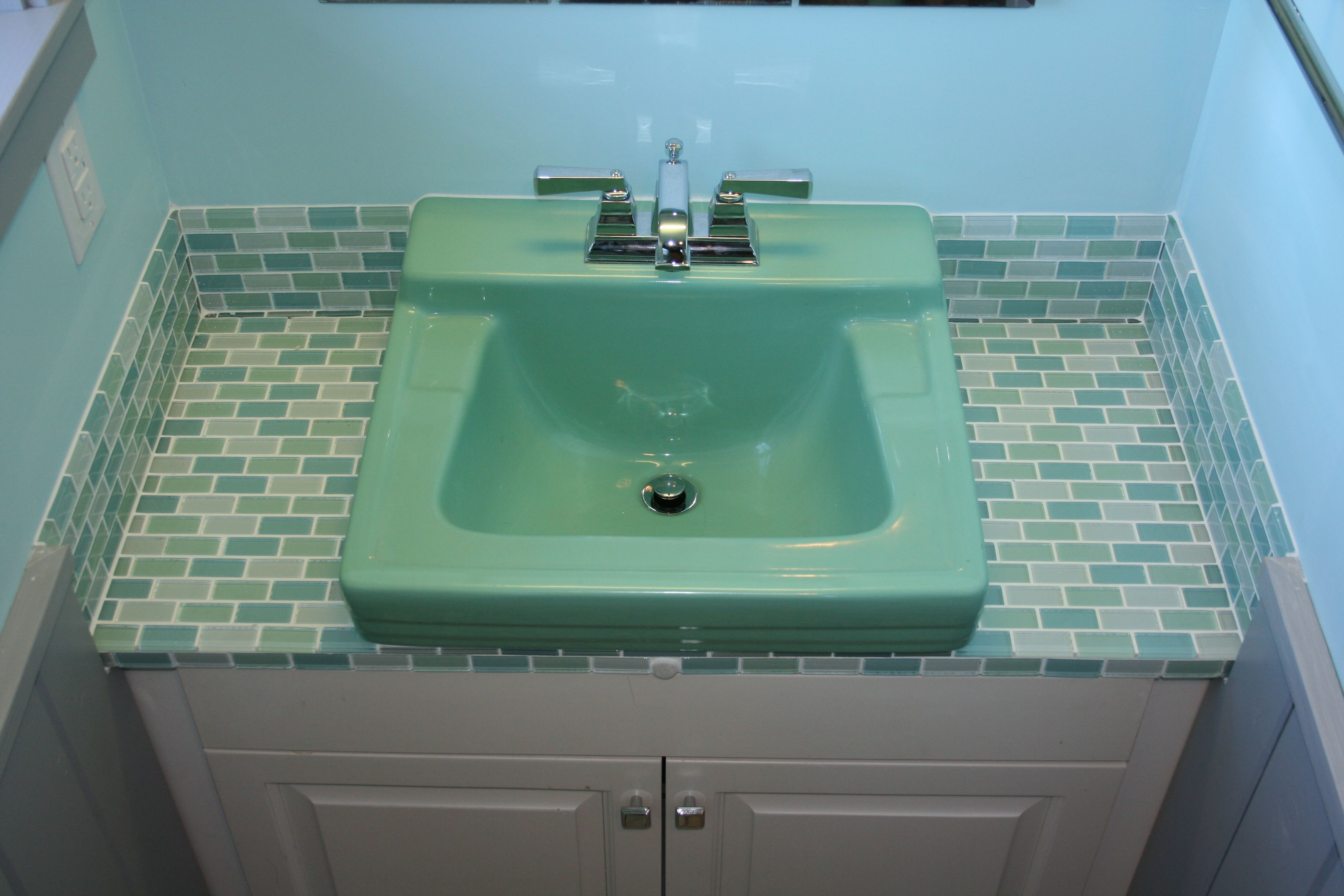 Thinking about this for my bathroom; different color tile though ...