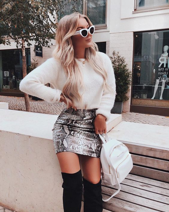 Make moves in this chic faux snakeskin beauty. Snakeskin print is a combination grey and black pattern.This skirt is a fitted mini skirt made to make bold moves. Zipper back closure. #wildrina #snakeskinskirt #fallstyle #falloutfit #fallstyle #sweateroutfit #cuteoutfit #casialoutfit #dressyoutfit #style #bloggerstyle #fallstyle2019 #animalprint #skirtoutfit #sweaterweather #cutefalloutfit #pumpkinpatchoutfit