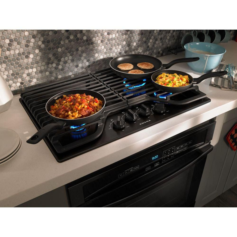 Amana 30 in gas cooktop in black with 4 burners