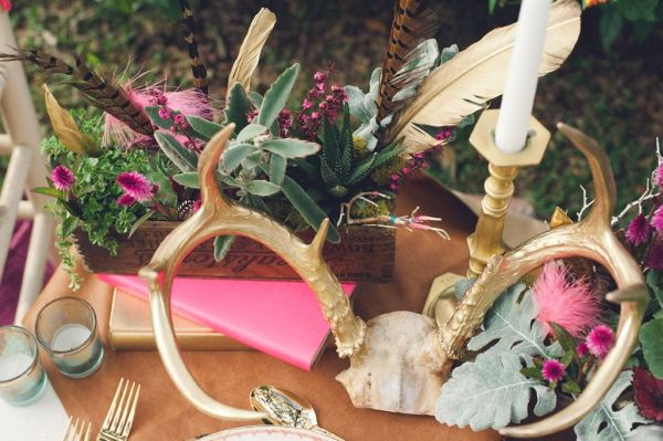 Boho table. antlers. flowers. candles. feathers.