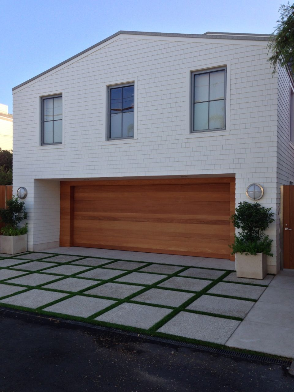 modern white garage door. love the paver driveway, wood garage door and clean lines of house. modern white n