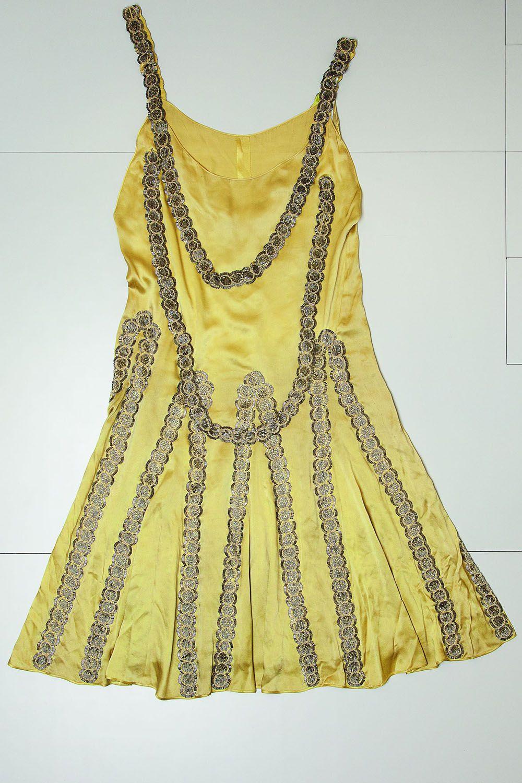 Evening dress, 1925  Silk and satin green absinthe, spangled and beaded bands    - HarpersBAZAAR.com