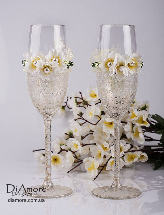 Toasting flutes, ivory spring theme wedding champagne glasses, hand decorated on Etsy, $47.00. Love!!