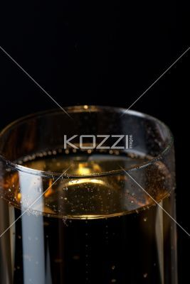champagne glass on black background. - Close-up view of a champagne glass on black background.