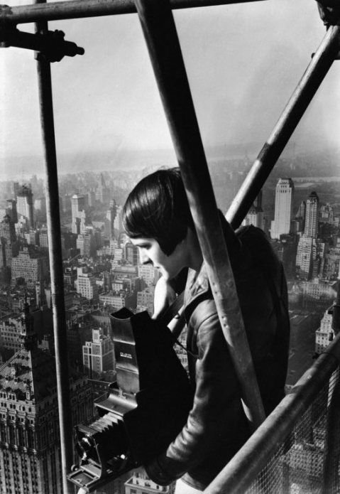 """""""Margaret Bourke-White.  Born in 1904 in the Bronx, Bourke-White was one of four original LIFE Magazine staff photographers and an accomplished photojournalist.  She holds a number of notable """"firsts"""" to her name — my favorites include the fact that she was the first woman war correspondent and was the first woman allowed to fly on combat missions (both during WWII)"""""""