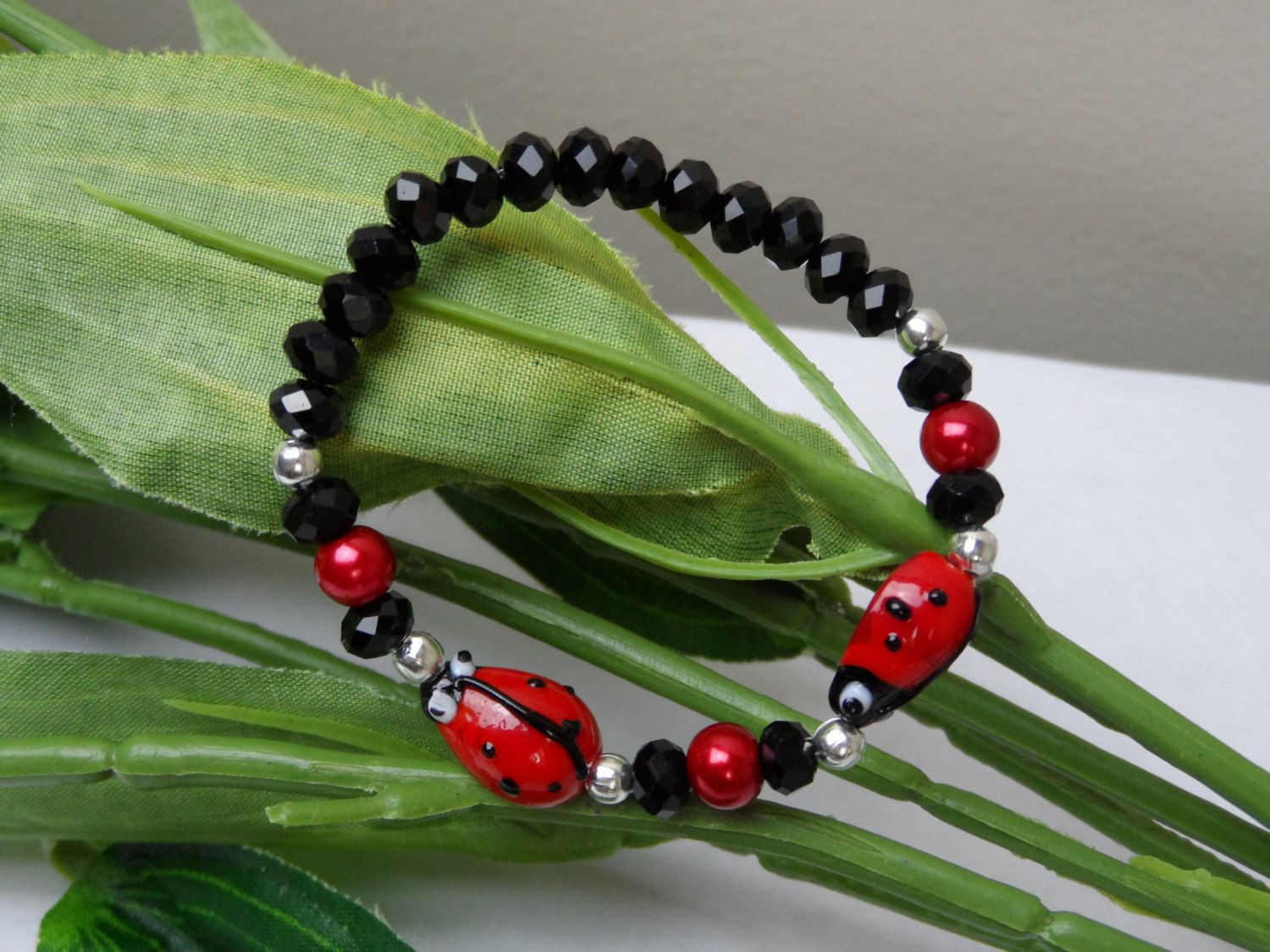 A personal favorite from my Etsy shop https://www.etsy.com/listing/210849233/girls-ladybug-stretchy-braceletlampwork