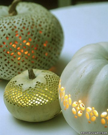 Decorating with white lace-carved pumpkins makes me think autumn fairy land wedding.