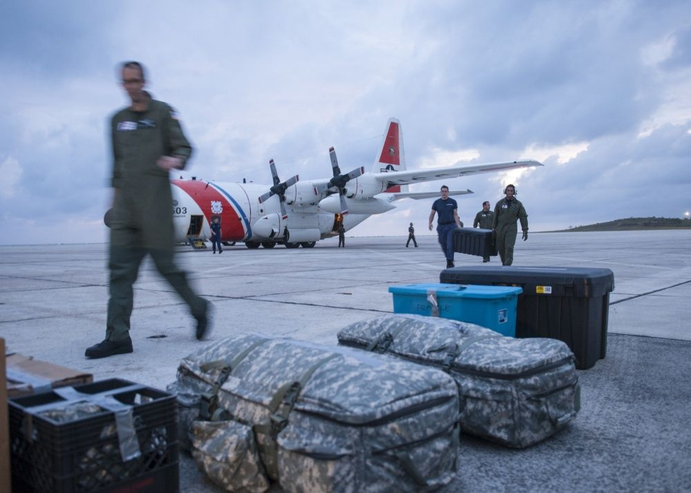 Crew members aboard an HC-130 Hercules airplane from Air Station Clearwater deliver medical supplies to Guantanamo Bay, Cuba, Thursday, Oct. 6, 2016 to support post Hurricane Matthew relief efforts.