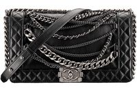 CHANEL's classic quilted bag adorned with extra chains for a punk look for fall