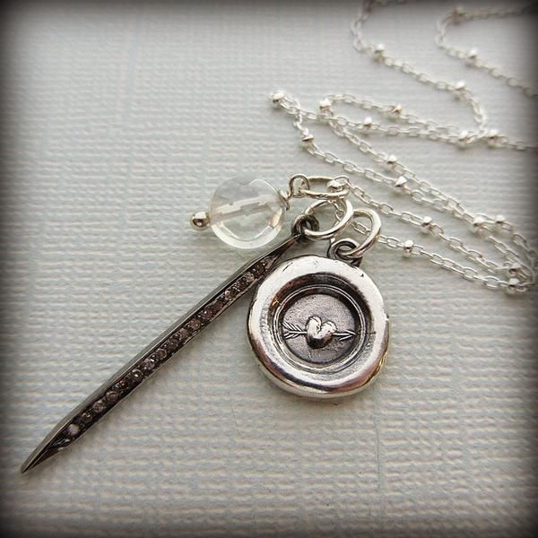 This handmade wax seal charm depicts a pierced heart and is accented with a genuine pave diamond spike and a mysterious moonstone that flashes and gleams in the sunlight. Very pretty and sparkly combination!