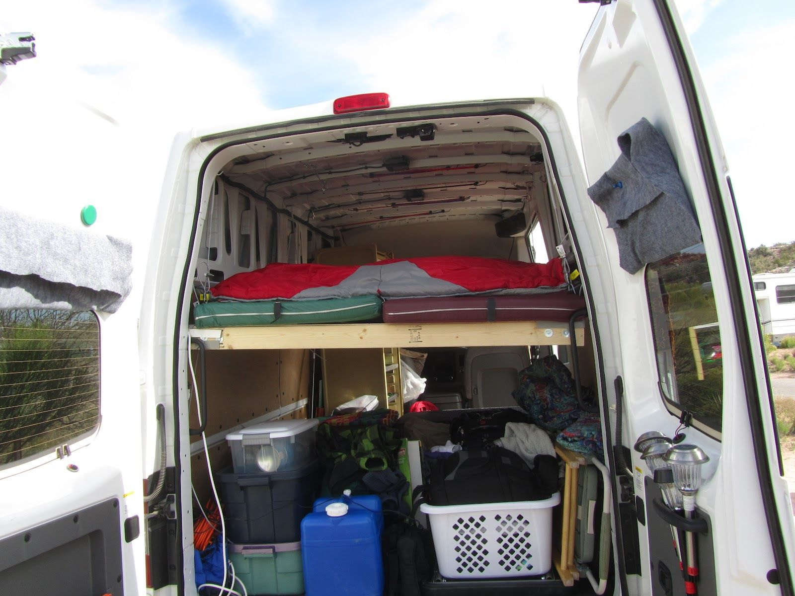 Hanging homemade bed for nissan nv 2500 hd works camper van hanging homemade bed for nissan nv 2500 hd works vanachro Images