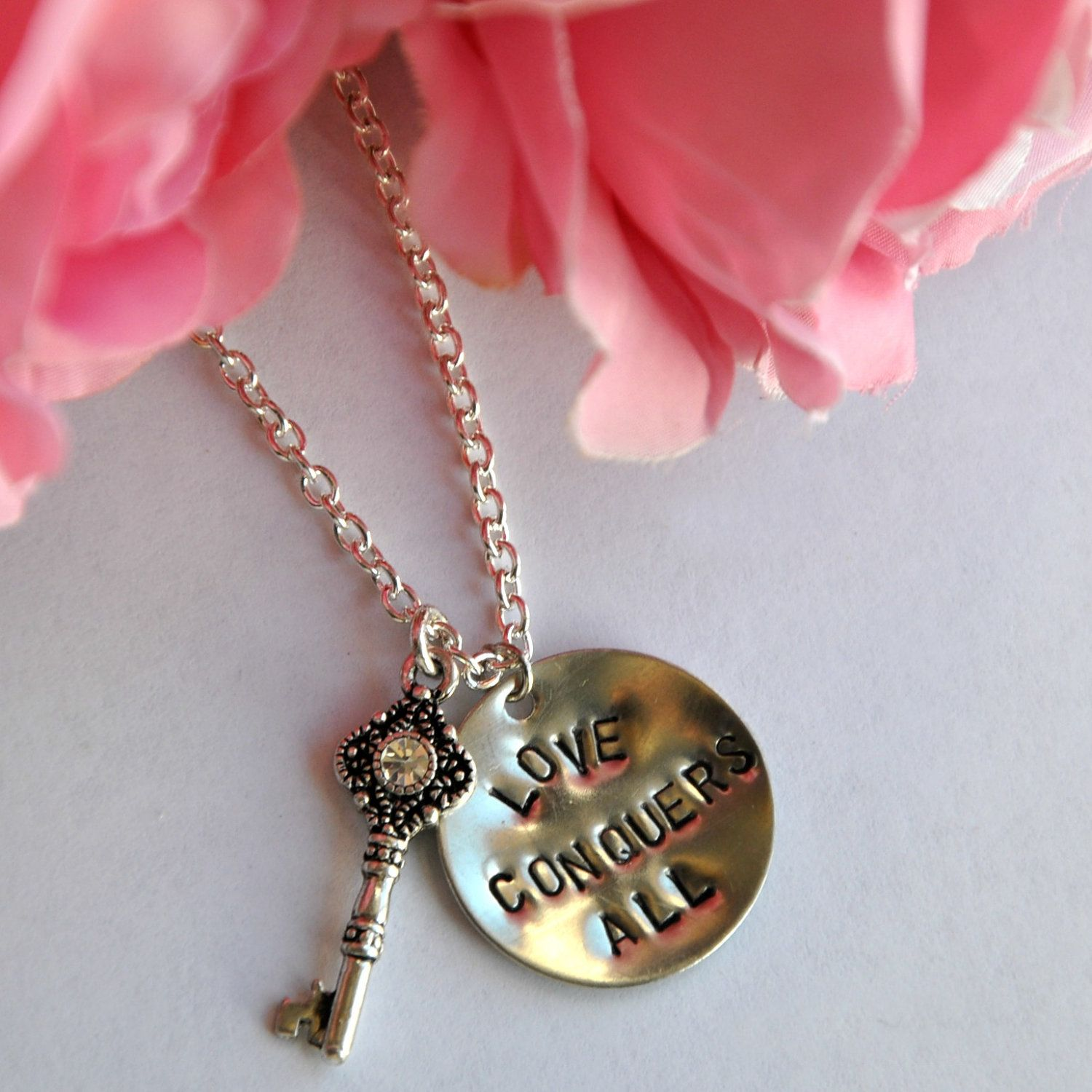 Hand Stamped Necklace - Love Conquers All - Skeleton Key - Nickel Silver Personalized Jewelry. $16.95, via Etsy.
