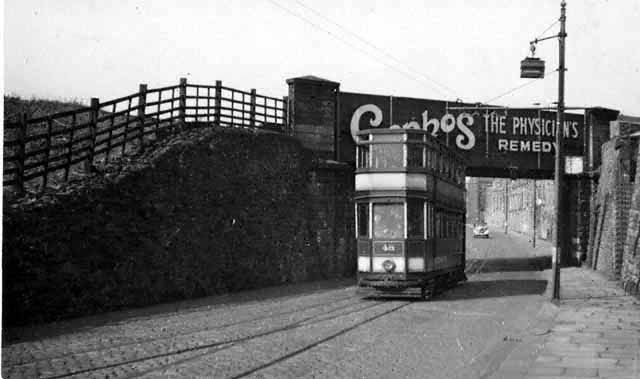 Church bound tram on the Accrington side of the railway bridge. This was the very first Blackburn tram picture that Roy Brook took. Note the interlaced track under the bridge.   © Roy Brook