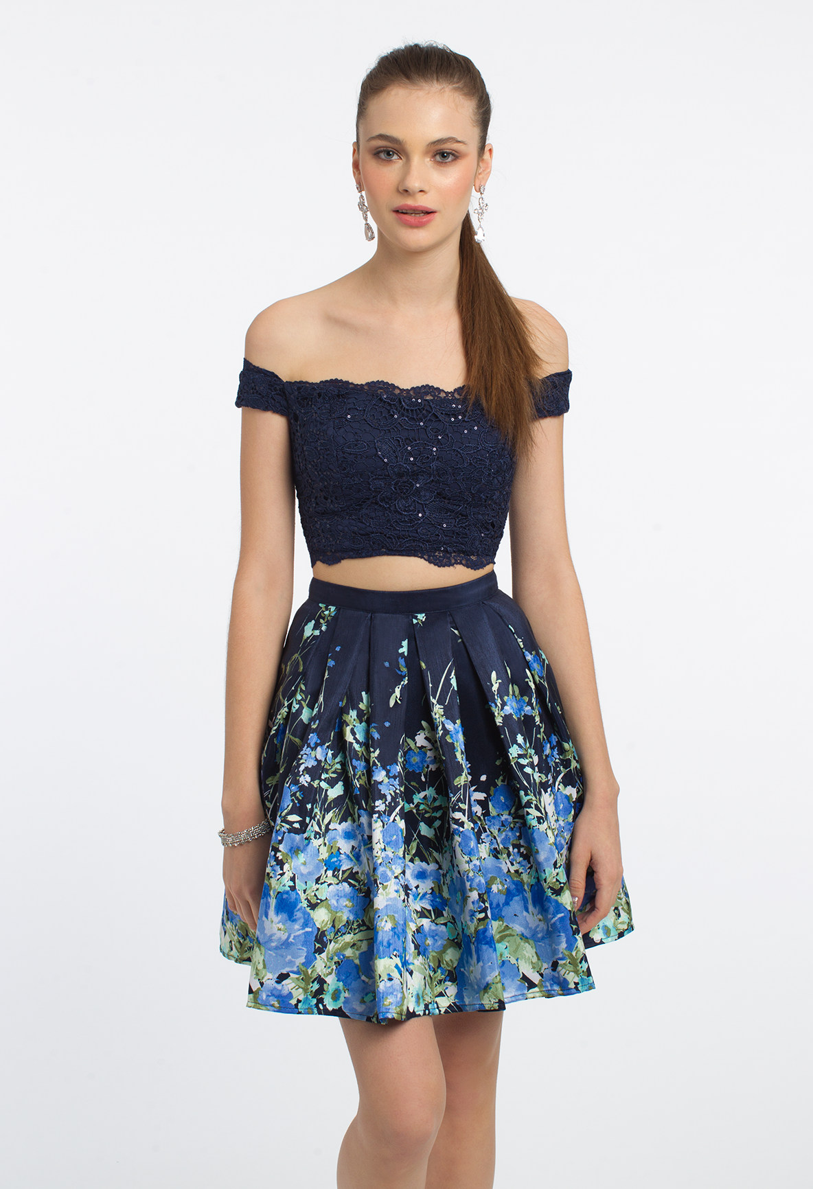 Take a twirl in this adorable party dress! The two piece style, lace off the shoulder crop top, and floral fit and flare skirt make this short cocktail dress too cute for an outdoor celebration. #camillelavie