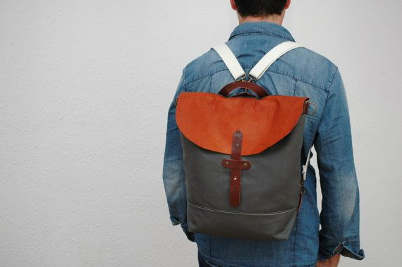 Backpack/messenger waxed canvashandles, closures leather trimmings,charcoal gray color