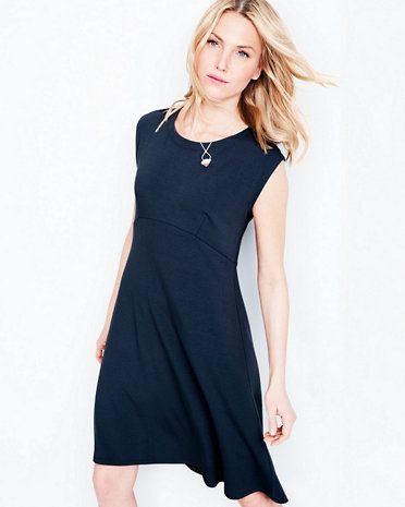 154710706b15 This put-together dress by Eileen Fisher features an empire waist ...