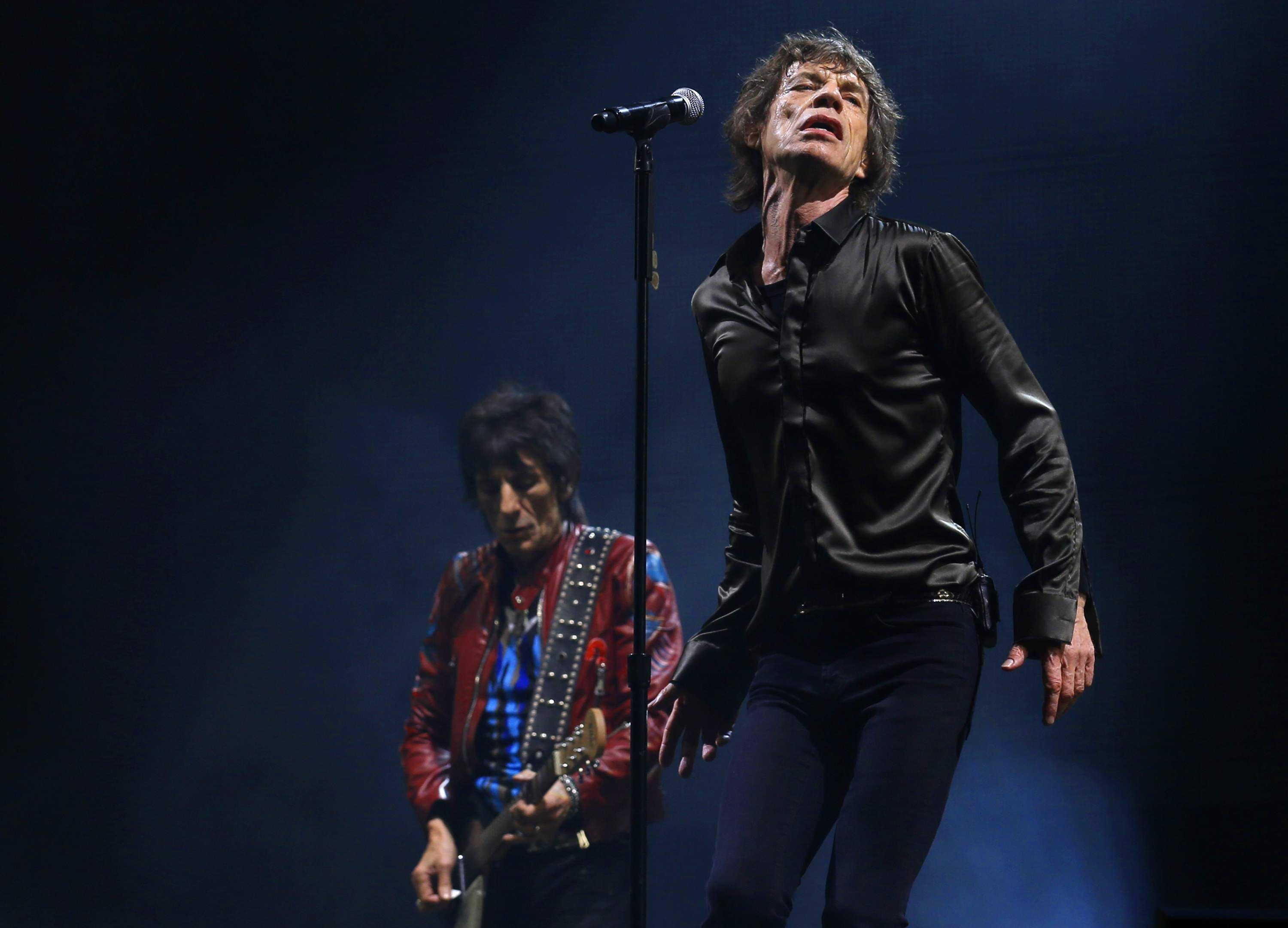 Ronnie Woods and Mick Jagger of the Rolling Stones perform on the Pyramid Stage at Glastonbury music festival at Worthy Farm in Somerset on June 29 TENS OF thousands of revellers watched the Rolling Stones make an energetic Glastonbury festival debut on Saturday (June 29) after half a century in the music business.