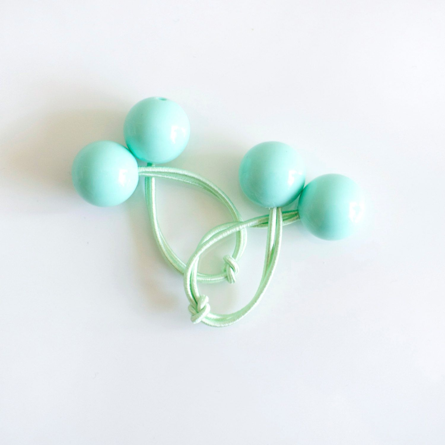 Mint green and mint. If you can remember the 80s you will remember these  easy to use and good looking Hair bobbles. eefd1f3ac24