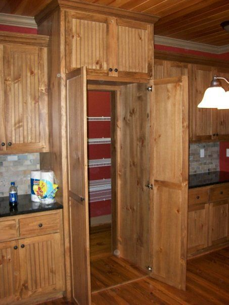 Tall Pantry Cabinet Doors Open To A Walk In Pantry Framed