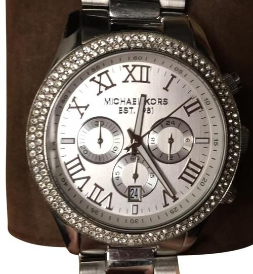 6d7324cc679e MICHAEL Michael Kors Silver Watch. Free shipping and guaranteed  authenticity on MICHAEL Michael Kors Silver