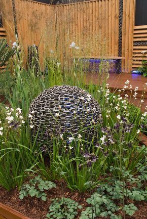 Garden Globe Lit At Evening In Deck Setting Plant Flower Stock