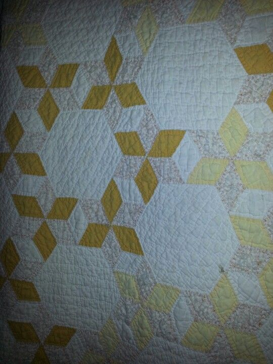 Love the yellow in this old quilt...