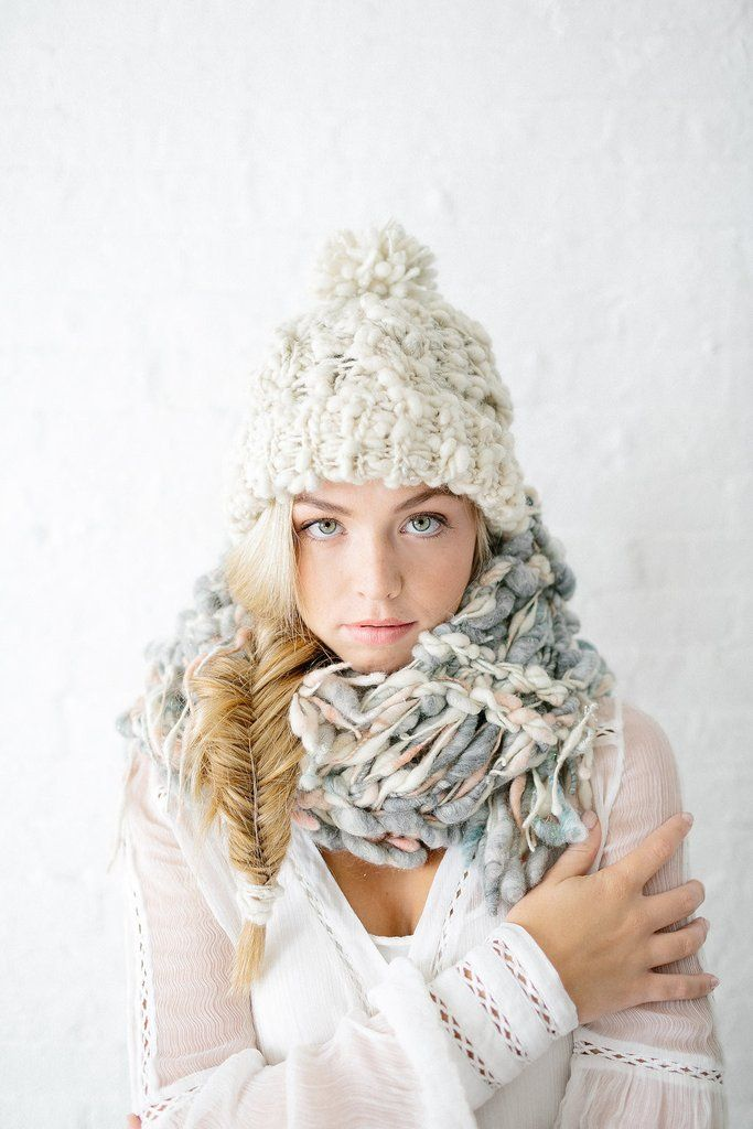 Our Snow Bunny Hatpattern features a rib brim, cable knitting and our own beautifulhandpsun yarn. Theuneven texture of the yarn and hint of sparkle throughou
