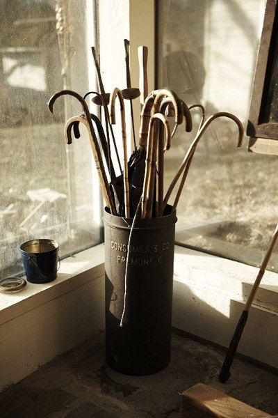 Walking Sticks In A Container By The Front Door Adds Charm