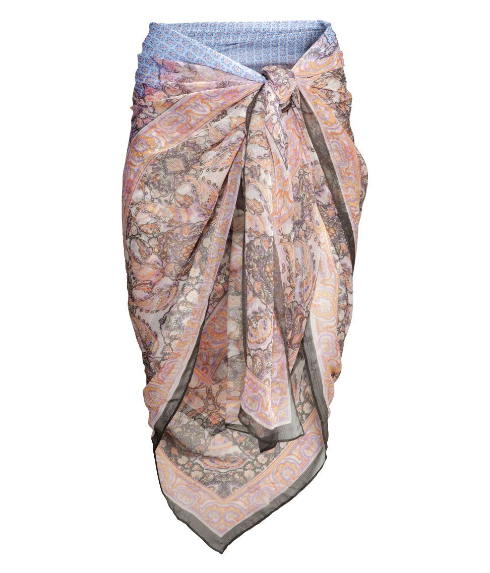 09018334b2 Wrap up post-dip in this blush-colored patterned sarong.