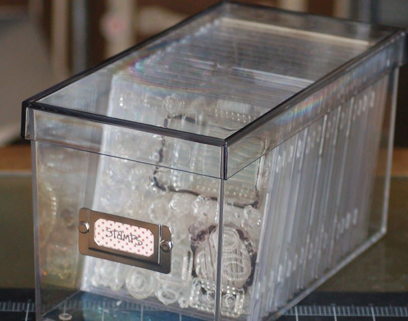 Great simple idea of storing the clear stamps in empty transparent cd cases and then those into CD storage boxes. In this case a clear one ...