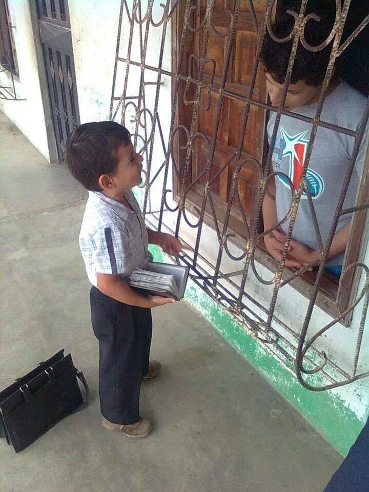 This little boy knows his Bible and can defend his faith. He is sharing a hope for the future with this young man. Jehovah's Witness children give Bible talks at a very young age.