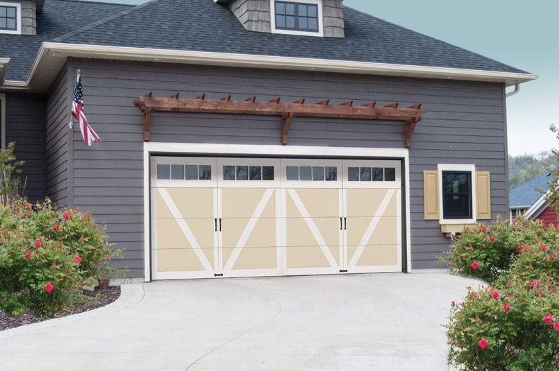 This Garage Door Withstands Heavy Winds Garage Doors Carriage House Doors House Front