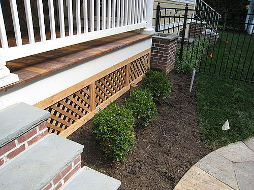 A Wood Deck And What To Do Underneath Landscapeadvisor Porch Lattice Front Porch Decorating Backyard