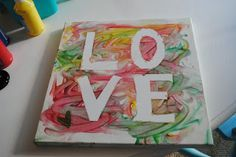 Toddler Finger Painting on Canvas. frame it and add it to the family photo collage on the wall!