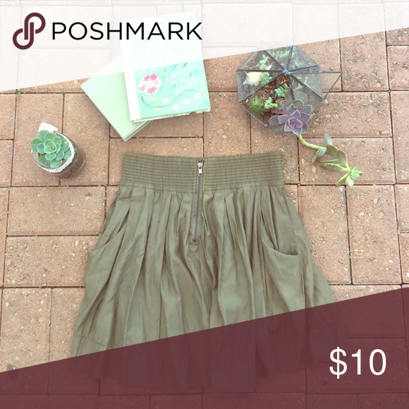 Army green skirt This is an army green skirt that has a thick elastic waist with a zipper in the front and added pockets. Charlotte Russe Skirts A-Line or Full