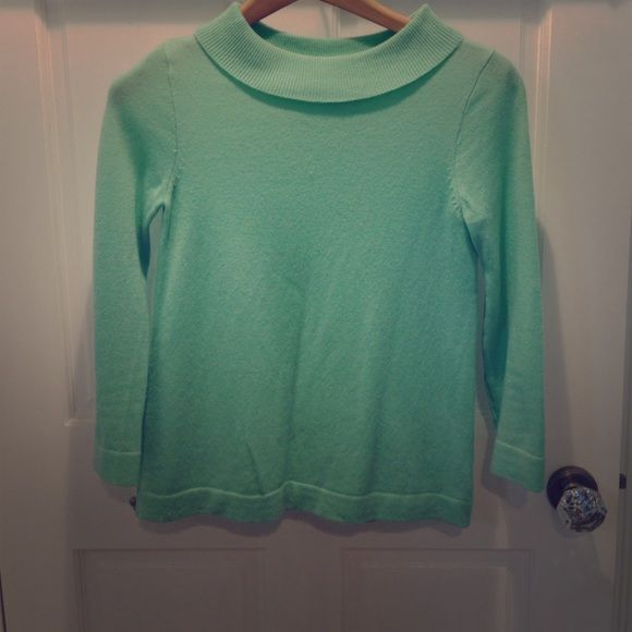 J. Crew cashmere Eva sweater 100% Italian cashmere in light spearmint color. Boat neck, rolled over collar, 3/4 length sleeves. Good condition. Hits at high hip. J. Crew Sweaters Crew & Scoop Necks