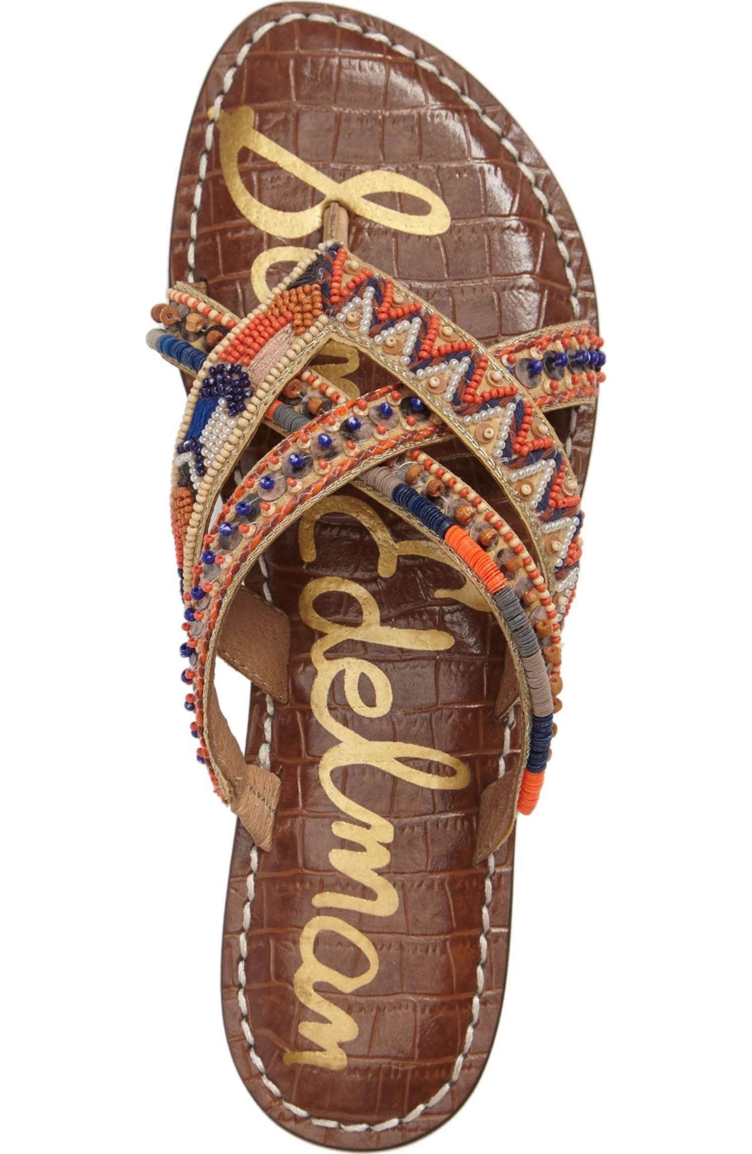 b93f48cc3da69 Interwoven straps embellished with colorful beads, chevron embroidery and  wooden discs brighten this leather slide sandal.
