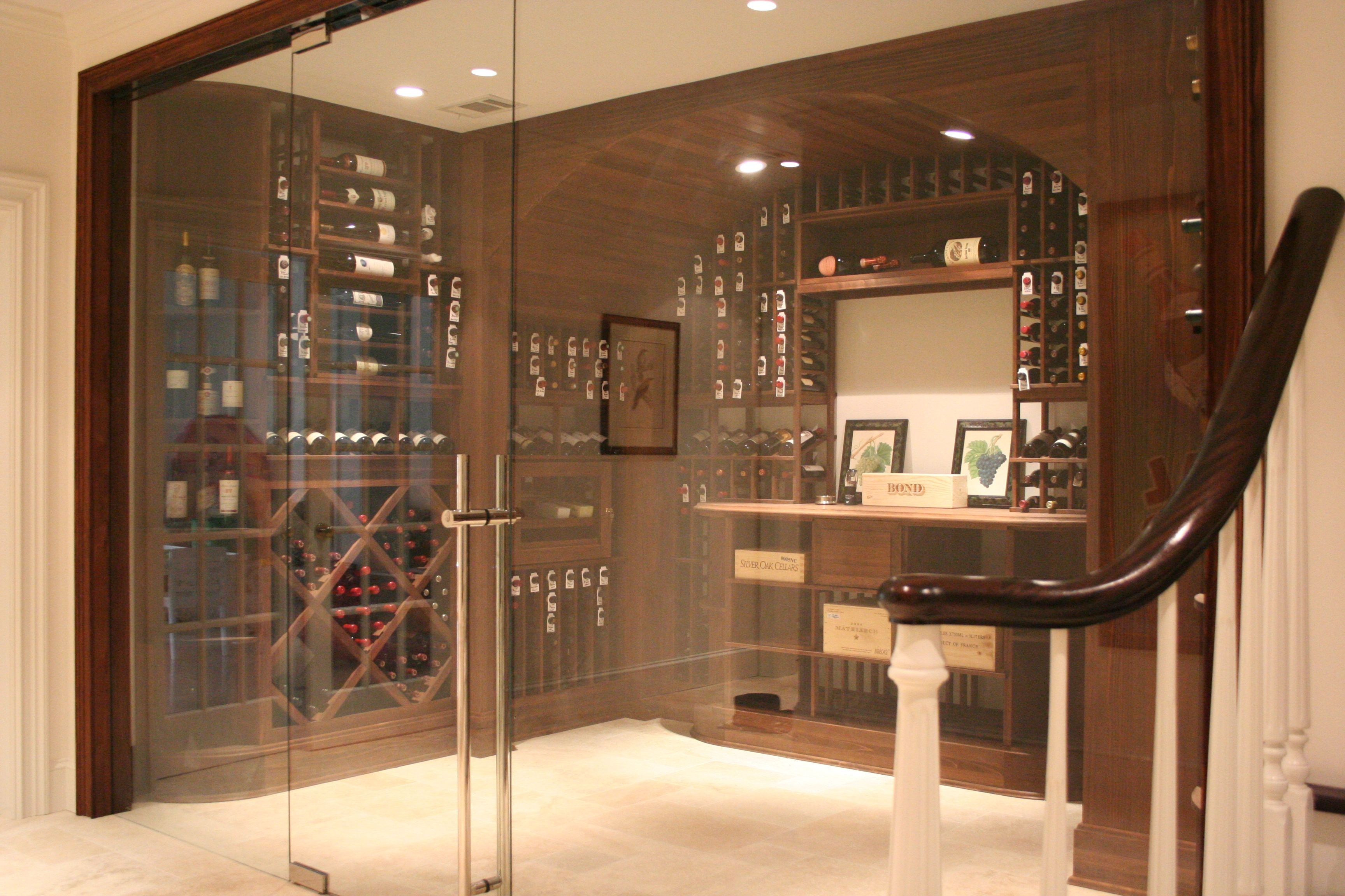 Traditional Wine Cellar With Modern Frameless Glass Doors And