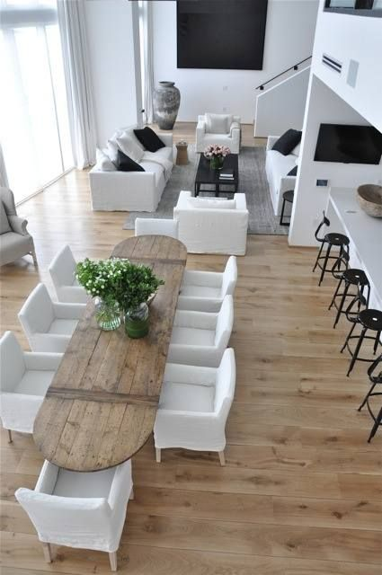 The Feel Of The Long Dining Table Along The Side Of The Kitchen Counter In  U Shape Which Serves As A Bar Too. Light Wood Colour At First For The Floor.