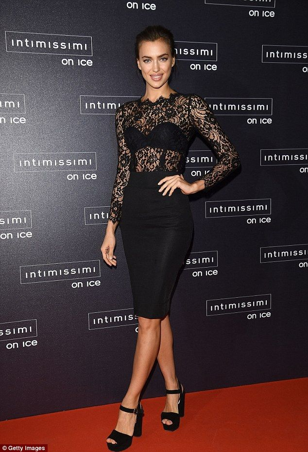 3ad50bdc660 Racy display  Irina Shayk looked sensational in a wide-set lace top and a  pencil skirt for.